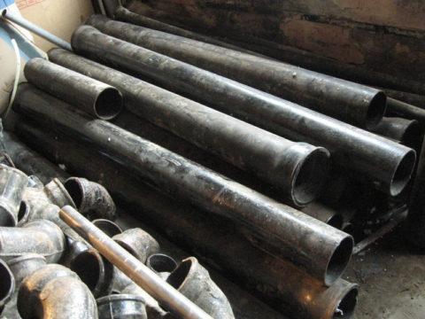Чугунные канализационные трубы и фасонные детали к ним