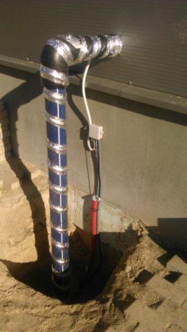 Открытый участок водопровода скабельным обогревом